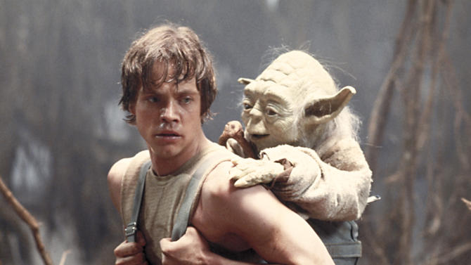 """FILE - This 1980 publicity image originally released by Lucasfilm Ltd., Mark Hamill as Luke Skywalker and the character Yoda appear in this scene from """"Star Wars Episode V: The Empire Strikes Back."""" The Library of Congress announced early Tuesday Dec. 28, 2010 that the film will be preserved by the Library of Congress as part of its National Film Registry.  (AP Photo/Lucasfilm Ltd)"""