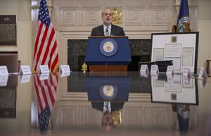 Federal Reserve Board Chairman Ben Bernanke speaks at the Federal Reserve Building in Washington, Monday, Dec. 16, 2013, before participating in the ceremonial signing of a certificate commemorating the 100th anniversary of the signing of the Federal Reserve Act. Joined by his two predecessors, Bernanke marked the 100th anniversary of the Federal Reserve by reflecting on the bold actions past chairmen have had to take in the best interest of the U.S. economy. (AP Photo/Pablo Martinez Monsivais)