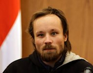 German journalist Billy Six is pictured during a press conference in Damascus on March 5, 2013. A Syrian minister handed him over to the Russian ambassador. His employers said he had been out of contact for almost four months