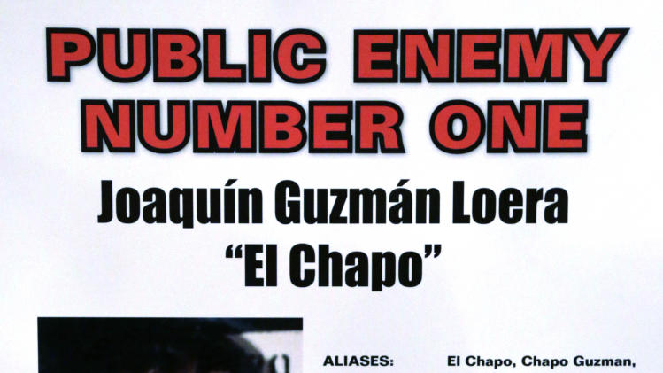 This poster displayed at a Chicago Crime Commission news conference Thursday, Feb. 14, 2013, in Chicago, shows Joaquin ``El Chapo'' Guzman, a drug kingpin in Mexico, who was deemed Chicago's  Public Enemy No. 1,  It is first time since prohibition, when the label was  created for Al Capone, that anyone else has been named Public Enemy No. 1.  (AP Photo/M. Spencer Green)