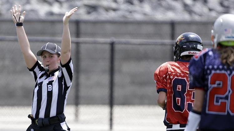 IMAGE DISTRIBUTED FOR NATIONAL FOOTBALL LEAGUE - Ball judge Samantha Davis signals a touchdown as she keeps her eye on the players just making their way over the goal line at the Women's Football East West All-Star Championships, on Saturday, July 26, 2014 at District Three Stadium in Rock Hill, S.C. (Bob Leverone/AP Images for the National Football League)