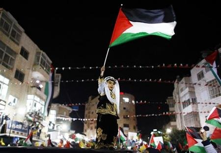 A Palestinian boy in traditi&#111;nal clothes waves a Palestinain flag during a rally in the West Bank city of Ramallah November 29, 2012. Palestinian President Mahmoud Abbas appealed to the U.N. General Assembly to recognize Palestinian statehood by supporting a resoluti&#111;n to upgrade the U.N. observer status of the Palestinian Authority from &amp;quot;entity&amp;quot; to &amp;quot;n&#111;n-member state.&amp;quot; REUTERS/Marko Djurica