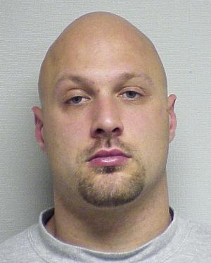 This 2006 booking photo provided by the Portsmouth, N.H., Police Department shows Cullen Mutrie, suspected of killing Greenland, N.H., Police Chief Michael Maloney and wounding four other officers Thursday, April 12, 2012, before he was found dead along with a female acquaintance early Friday morning.  (AP Photo/Portsmouth Police Department)