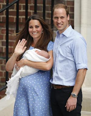The Duke and Duchess of Cambridge leave the Lindo Wing of St Mary's Hospital in London Tuesday July 23 2013, carrying their new-born son, the Prince of Cambridge, who was born Monday, into public view for the first time. The boy will be third in line to the British throne. (AP Photo/Jonathan Brady PA) UNITED KINGDOM OUT - NO SALES - NO ARCHIVES