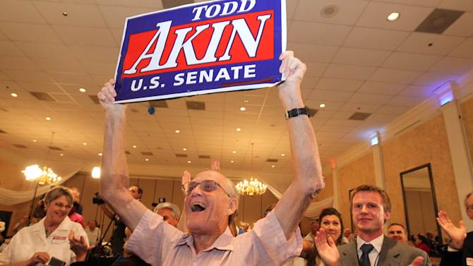 Steve Holloway of Lincoln County, Mo., celebrates word that U.S. Senate Todd Akin won the GOP primary at his campaign party at the Columns in St. Charles, Mo., on Tuesday, Aug. 7, 2012. (AP Photo/St. Louis Post-Dispatch, Christian Gooden)