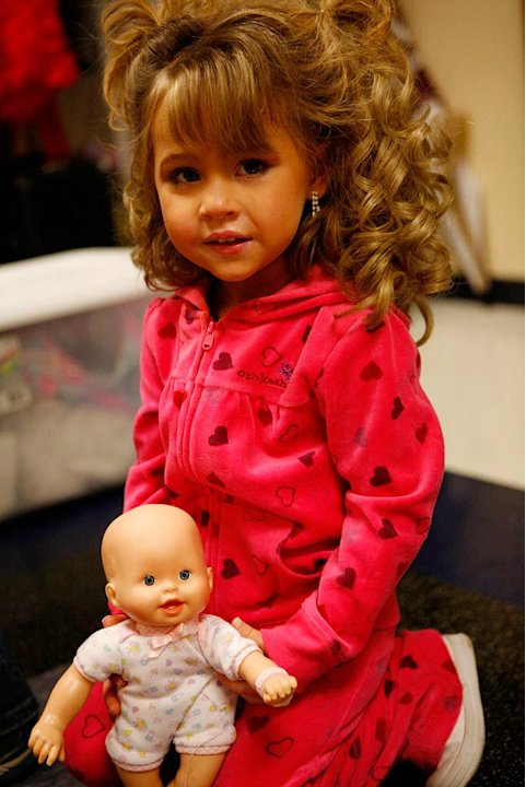 "Daylee plays with her doll backstage before the Southern Celebrity Beauty Pageant in Charleston, West Virginia as seen in ""Toddlers & Tiaras."""