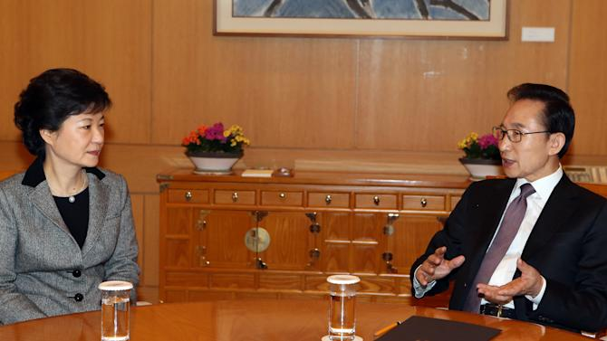 FILE - In this Feb. 12 2013 file photo, South Korean President Lee Myung-bak, right, talks with President-elect Park Geun-hye during their meeting about North Korea's nuclear test at the presidential Blue House in Seoul, South Korea. Even before she takes office Monday, Feb. 25, 2013, as South Korea's first female president, Park's campaign vow to soften Seoul's current hard-line approach to rival North Korea is being tested by Pyongyang's recent underground nuclear detonation. Pyongyang, Washington, Beijing and Tokyo are all watching to see if Park, the daughter of a staunchly anti-communist dictator, pursues an ambitious engagement policy meant to ease five years of animosity on the divided peninsula or if she sticks with the tough stance of her fellow conservative predecessor, Lee Myung-bak. (AP Photo/Yonhap, Do Kwang-hwan) KOREA OUT