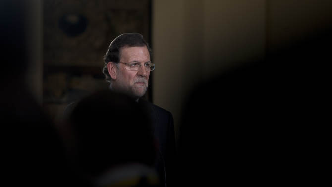 """Spain's Prime Minister Mariano Rajoy pauses during a news conference at the Moncloa Palace in Madrid, Friday Dec. 28, 2012. In his end of year assessment, Mariano Rajoy said Friday the crisis had been worse than he had anticipated and that the first half of 2013 will be """"very hard,"""" but that the economy should begin to recover in the second semester. Rajoy says the country's economy will be in recession for some time and faces a tough year ahead as it grapples with a deep financial crisis and 25 percent unemployment. (AP Photo/Paul White)"""