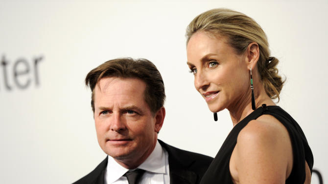 "Actors Michael J. Fox and Tracy Pollan attend ""Lincoln Center Presents: An Evening With Ralph Lauren"" at Alice Tully Hall on Monday, Oct. 24, 2011 in New York. (AP Photo/Evan Agostini)"