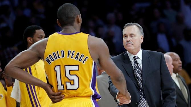 Los Angeles Lakers head coach Mike D'Antoni, right, shakes hands with Metta World Peace after an NBA basketball game against the Brooklyn Nets in Los Angeles on Tuesday, Nov. 20, 2012. The Lakers won 95-90. (AP Photo/Jae C. Hong)