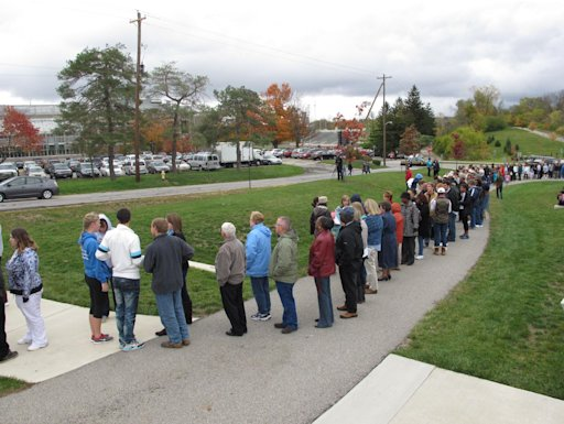 A line of people waiting to see first lady Michelle Obama snakes through the campus of Ohio Wesleyan University in Delaware, Ohio, on Monday, Oct. 15, 2012. (AP Photo/Andrew Welsh-Huggins)