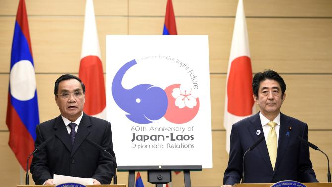 Laotian PM Thammavong and Japan's PM Abe attend a joint news conference at Abe's official residence in Tokyo