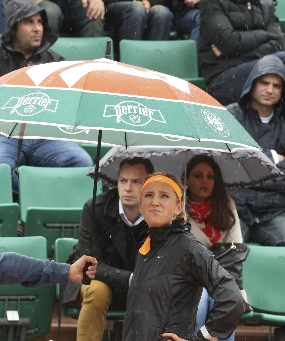 Victoria Azarenka of Belarus looks up at the sky as she waits for the rain to stop in her second round match against Germany's Annika Beck at the French Open tennis tournament, at Roland Garros stadium in Paris, Thursday, May 30, 2013. (AP Photo/Michel Euler)