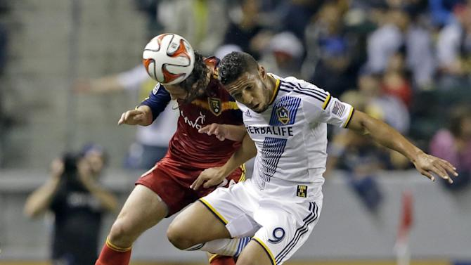 Real Salt Lake midfielder Ned Grabavoy, left, and Los Angeles Galaxy forward Samuel go for a head ball during the first half of an MLS soccer game in Carson, Calif., Saturday, March 8, 2014