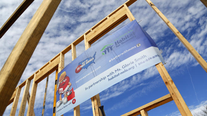 The M&M's and Habitat For Humanity logo is seen at the launch of M&M'S 'M' Prove America' campaign, which is designed to fund the construction of Habitat for Humanity homes across the country, Friday, Feb. 1, 2013 in New Orleans. (Jonathan Bachman / AP Images for Habitat For Humanity)