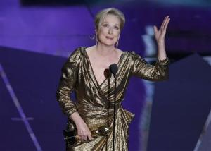 """Actress Meryl Streep accepts the Oscar for Best Actress for her role in """"The Iron Lady"""" at the 84th Academy Awards in Hollywood"""