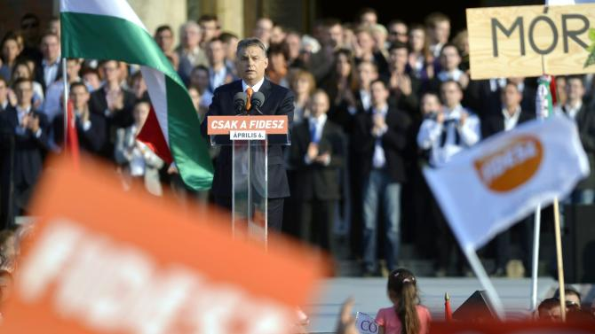 FILE - In this March 29, 2014 file picture Hungarian Prime Minister and Chairman of ruling centre right Fidesz party Viktor Orban addresses the election rally of Fidesz in Heroes' Square in Budapest, Hungary. Polls expect Viktor Orban's Fidesz and its small ally, the Christian Democrats, to win easily on Sunday April 6, 2014 and they may even retain the two-thirds majority in the legislature gained in 2010 which allowed them to pass a new constitution, adopt unconventional economic policies, centralize power and grow the state's influence at the expense of the private sector. (AP Photo/MTI, Laszlo Beliczay,File)