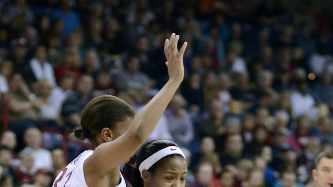 Georgia's Jasmine James (10) drives against Stanford's Amber Orange in the first half of a regional semifinal game in the NCAA women's college basketball tournament, Saturday March 30, 2013 in Spokane, Wash. (AP Photo/Jed Conklin)