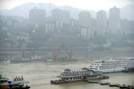 This file photo shows a general view of the Chaotian dock along the Yangtze river in China's southwestern city of Chongqing. China has launched a huge manhunt for a fugitive armed robber accused of killing nine people, most recently a police officer, in Chongqing, an official and state media said on Monday