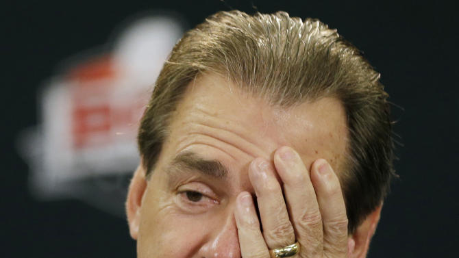 Alabama head coach Nick Saban reacts to a question during a news conference for the BCS National Championship college football game Sunday, Jan. 6, 2013, in Miami. (AP Photo/David J. Phillip)