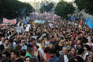 <p>Thousands of people protest against the Spanish government's latest austerity measures in Madrid. Spanish police fired rubber bullets and charged protestors in central Madrid early Friday at the end of a huge demonstration against economic crisis measures.</p>
