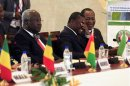 Sierra Leone's President Ernest Bai Koroma, Togo's President Faure Gnassingbe and Burkina Faso's President Blaise Compaore attend a summit on the crisis in Mali and Guinea Bissau, at the Fondation Felix Houphouet Boigny in Yamoussoukro