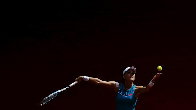 Radwanska of Poland serves the ball to Dellacqua of Australia during their match at the Madrid Open tennis tournament in Madrid