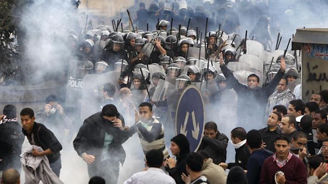 FILE - In this Friday, Jan. 28, 2011 file photo, Egyptian anti-government activists clash with riot police in Cairo, Egypt. More Arabs are politically engaged than ever before, demanding to be heard. They're learning what it means to question everything and everyone after decades under heavy autocracies where discussion, innovation and public participation were discouraged or crushed. This week, as Egyptians prepare to mark on Friday the anniversary of the start of the revolution that swept aside Hosni Mubarak, the issue seems to come up at every panel that even tangentially touches on politics or strategy. (AP Photo/Ben Curtis, File)