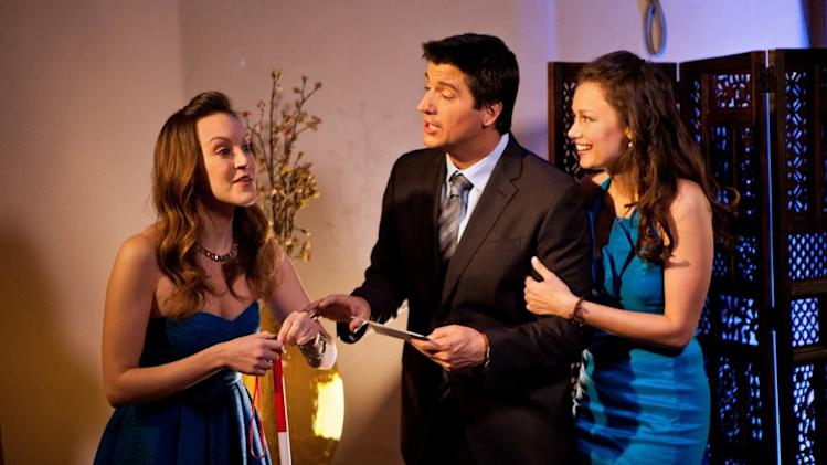 "This undated image released by Paramount Pictures shows Ken Marino, center, flanked by Carla Gallo, left, and Deanna Russo in a scene from the Yahoo Web series ""Burning Love,"" a spoof of the popular romance reality series, ""The Bachelor."" (AP Photo/Paramount Pictures)"