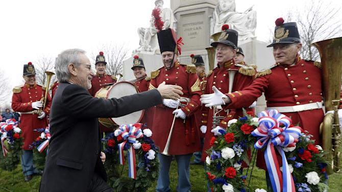 "FILE - This Nov. 19, 2012 file photo shows director Steven Spielberg, left, greeting members of ""The President's Own Band,"" a musical group of Civil War re-enactors, during a ceremony to mark the 149th anniversary of President Abraham Lincoln's delivery of the Gettysburg Address at Soldier's National Cemetery in Gettysburg, Pa. Gettysburg is expecting an increase in visitors in 2013 as the town marks 150 years since the famous Civil War battle with a variety of events.  (AP Photo/Patrick Semansky, file)"