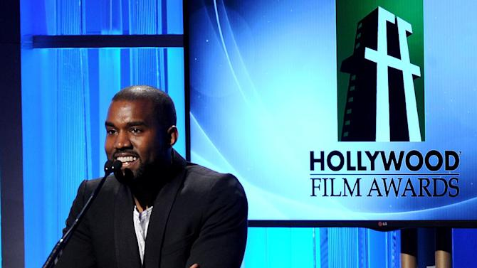 FILE - In this Tuesday, Oct. 22, 2013 file photo, recording artist Kanye West speaks onstage during the 17th Annual Hollywood Film Awards Gala at the Beverly Hilton Hotel in Beverly Hills, Calif. Los Angeles County prosecutors declined to file charges against West on Friday, Jan. 31, 2014, after the man the rapper allegedly punched in a Beverly Hills chiropractor's office declined to cooperate with the case. (Photo by Frank Micelotta/Invision/AP, File)
