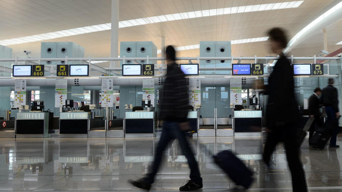 The empty Delta Air Lines check in area at the international airport in Barcelona, Spain, Tuesday, Oct. 30, 2012. In the aftermath of superstorm Sandy, airports  hundreds of thousands of travelers across the U.S. and around the world are stranded. (AP Photo/Manu Fernandez)