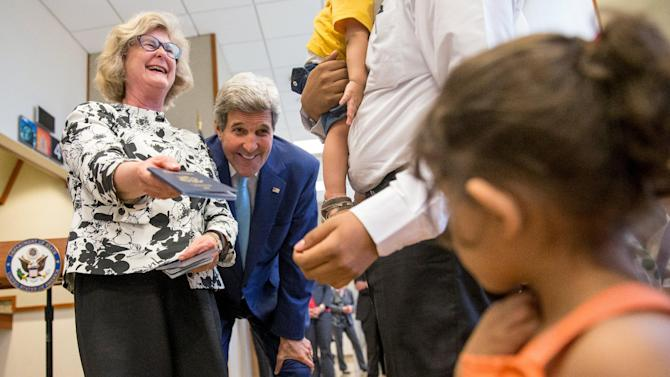 U.S. Secretary of State John Kerry and State Department Principal Deputy Assistant Secretary for Consular Affairs Michele Bond laugh in Djibouti