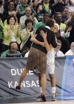 Notre Dame guard Skylar Diggins right gets a hug from coach Muffet McGraw during the second half of the regional final of the NCAA women's college basketball tournament Tuesday, April 2, 2013, in Norfolk, Va. Notre Dame won 87-76. (AP Photo/Steve Helber)