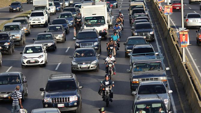 In this photo taken Nov. 21, 2012, commuters wait in heavy traffic on a main highway in Caracas, Venezuela. On the chaotic streets of Venezuela's capital of 6 million people, car stereos thump loudly with salsa and reggaeton tunes, while motorcycle taxi drivers honk in high-pitched shrieks as they zip through bumper to bumper traffic at rush hour. Growing numbers of Venezuelans are saying they're fed up with the noise that they say is getting worse, and the numbers of complaints to the authorities have risen in recent years. (AP Photo/Ariana Cubillos)
