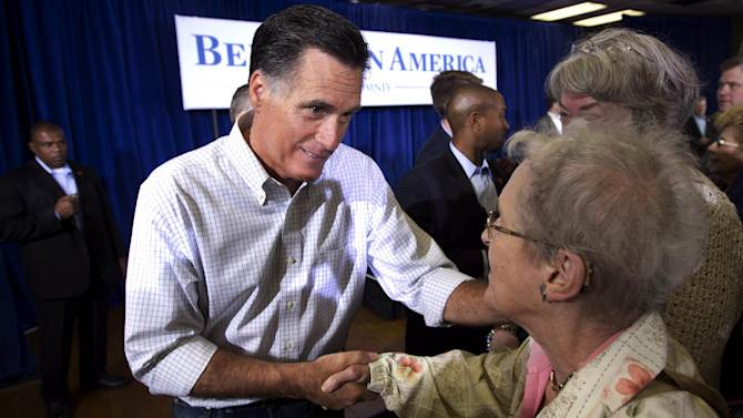 Republican presidential candidate former Massachusetts Gov. Mitt Romney greets people during a campaign stop Sunday, March 18, 2012 in Moline, Ill. (AP Photo/Steven Senne)