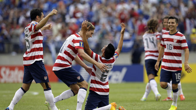 Teammates celebrate with United States' Joe Corona (6) after he scored a goal against El Salvador during the first half in the quarterfinals of the CONCACAF Gold Cup soccer tournament on Sunday, July 21, 2013, in Baltimore. (AP Photo/Patrick Semansky)