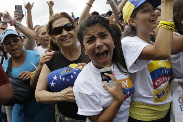 Supporters of opposition Presidential Candidate Henrique Capriles cheer during a campaign rally in Caracas, Venezuela, Sunday, Sept. 30, 2012. Capriles is running against President Hugo Chavez in the