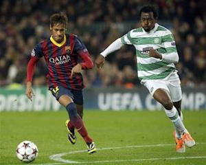 Barcelona's Neymar and Celtic's Ambrose challenge for the ball during their Champions League soccer match in Barcelona