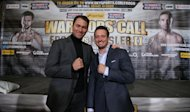 Promoters Eddie Hearn and Kalle Sauerland pose together for the photographers ahead of their double World Championship title fight tomorrow involving Britain's Carl Froch and Denamrk's Mikkel Kessler during the weigh in at the O2 Arena, London.