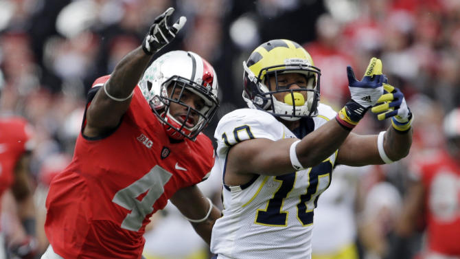 Michigan wide receiver Jeremy Gallon (10) can't hang on to a pass asnst Ohio State defensive back C.J. Barnett (4) defends in the first quarter of an NCAA college football game Saturday, Nov. 24, 2012, in Columbus, Ohio. (AP Photo/Mark Duncan)