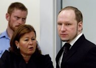 Anders Behring Breivik stands in the courtroom in Oslo with his defence lawyer Vibeke Hein Baeraon. Young Norwegians wounded in Breivik's shooting rampage have testified for the first time about how he coldly hunted them down