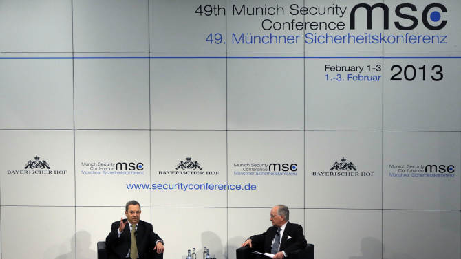 Ehud Barak, Defence Minister of Israel, left, gestures next to Wolfgang Ischinger, Chairman of the Security Conference, during a meeting at the Conference in Munich, southern Germany, on Sunday, Feb. 3, 2013. The 49th Munich Security Conference started Friday until Sunday afternoon with experts from 90 delegations. (AP Photo/Matthias Schrader)