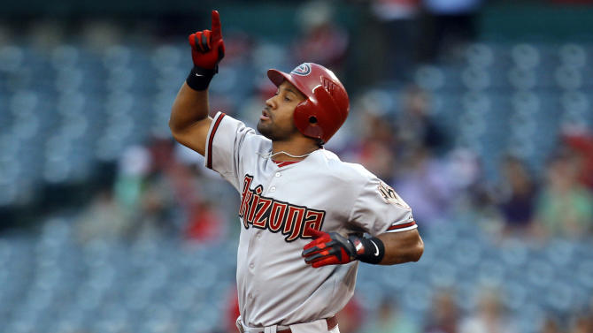 In this June 15, 2012, photo, Arizona Diamondbacks center fielder Chris Young gestures during the Diamondbacks' baseball game against the Los Angeles Angels in Anaheim, Calif. The Diamondbacks traded Young to the Oakland Athletics on Saturday, Oct. 20, 2012, for infielder Cliff Pennington. (AP Photo/Jae C. Hong)