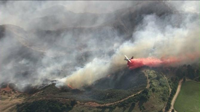Out of Control Wildfire Burning in Banning, Evacuations Underway