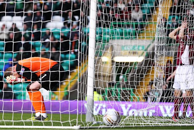 Arbroath goalkeeper Scott Morrison, left, watched as Alex Keddie scored an own goal against Celtic