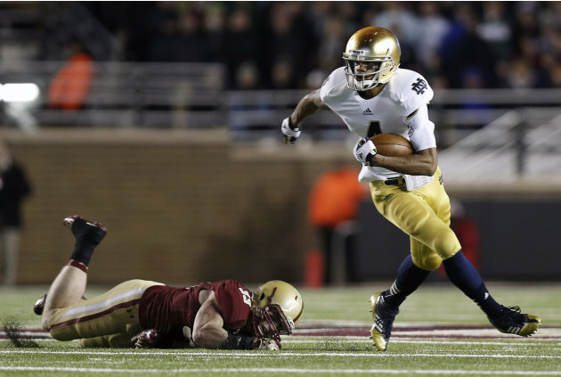 Notre Dame running back George Atkinson III runs past Boston College linebacker Tim Joy during the first half of an NCAA college football game in Boston on Saturday, Nov. 10, 2012. (AP Photo/Winslow T