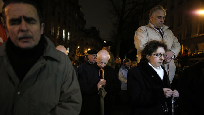 Opponents to gay marriage pray during a demonstration in Paris, Tuesday, Jan. 29, 2013. The French government has presented a divisive plan to legalize gay marriage and adoption to Parliament for debate. (AP Photo/Christophe Ena)
