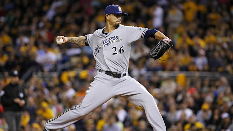 Milwaukee Brewers starting pitcher Kyle Lohse (26) delivers during the fourth inning of a baseball game against the Pittsburgh Pirates in Pittsburgh Friday, April 18, 2014. (AP Photo/Gene J. Puskar)