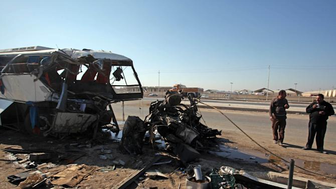 The wreckage of a bus is seen at the site of a traffic accident in Hillah, about 60 miles (95 kilometers) south of Baghdad, Iraq, Friday, Dec. 3, 2010. Dozens of people including Iranian pilgrims visiting Shiite holy sites in Iraq, died Friday when two buses collided head-on south of Baghdad, official and eyewitnesses said.(AP Photo/Alaa al-Marjani)
